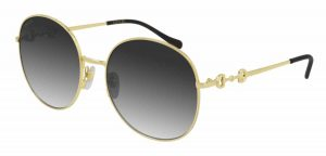 Gucci Gold Sunglasses with grey lens on sale